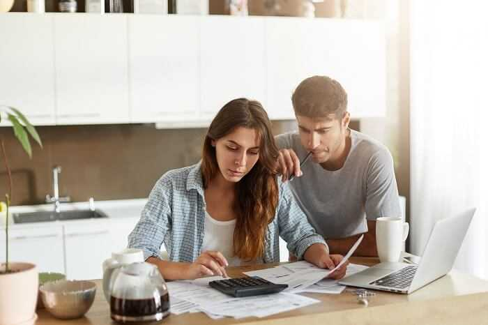 Couple checking their budget for packing and moving