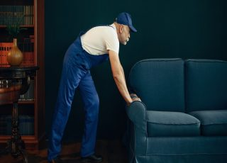 A mover is shifting furniture