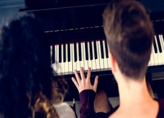 Couple are practicing piano after relocation